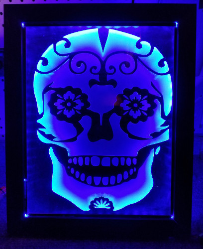 tribal skull sandcarving in led stand.